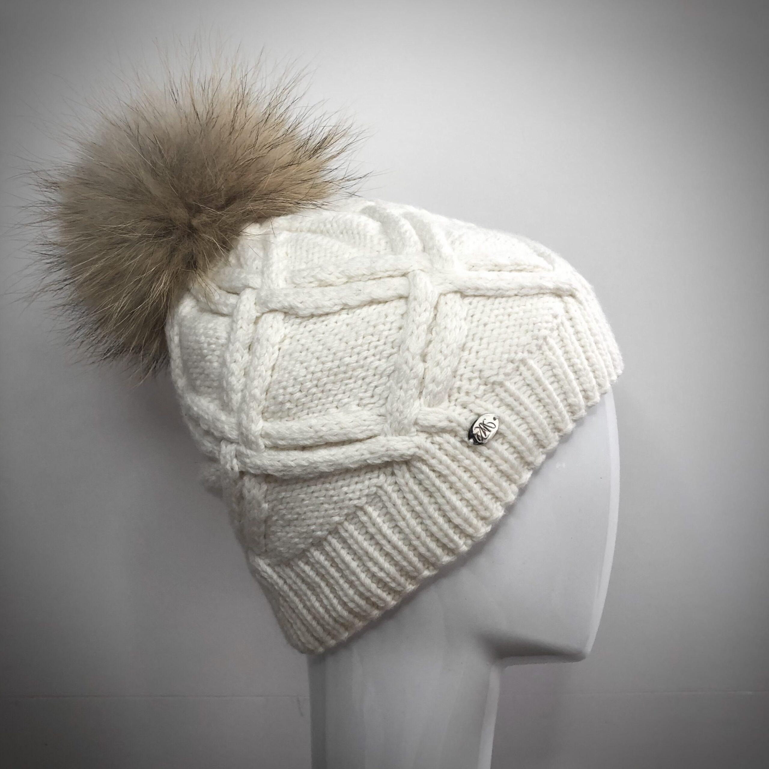 High quality hand knitted pom pom hat Average size